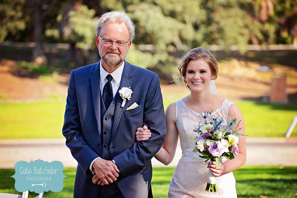 Leslie's father walks his daughter down the aisle.