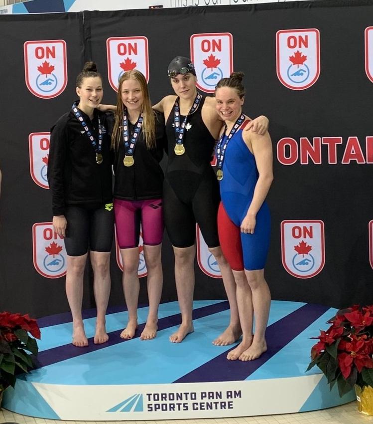 Gold-medal winning 4x100 Free Relay team of (L—>R) Haley Klenk, Axana Merckx, Kyla Leibel, Chantel Jeffrey