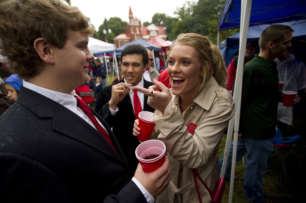 Chance Lauery, (from left) Charles Ponder and Julie Abdel along with fellow fans of Ole Miss Rebels football enjoy tailgating at The Grove on the University of Mississippi campus before the Rebels take on Texas A&M University.