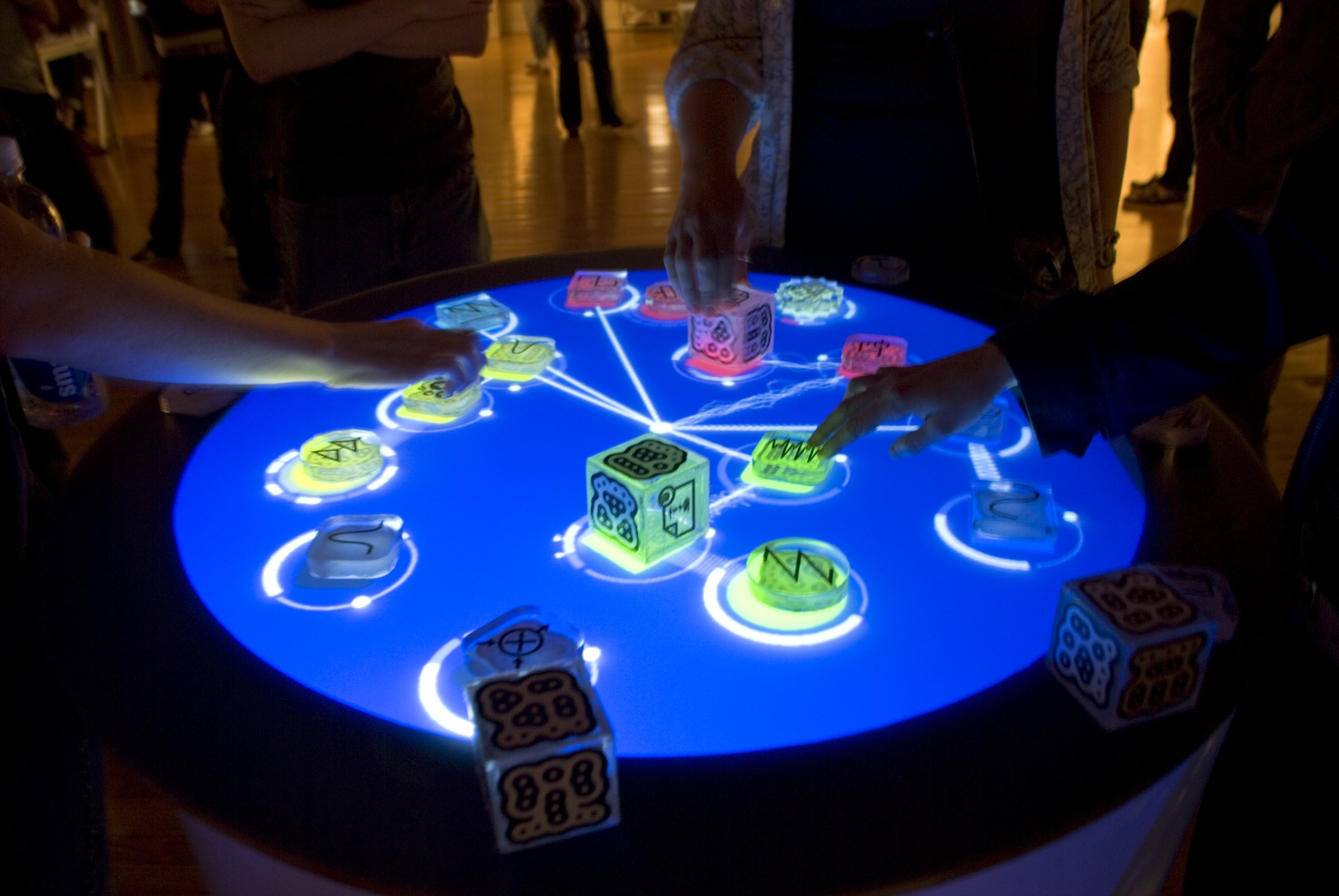Reactable: An example of a musical instrument that is built using a tangible user interface. Music is created by positioning cubes on the table, rotating them, and creating links between cubes.