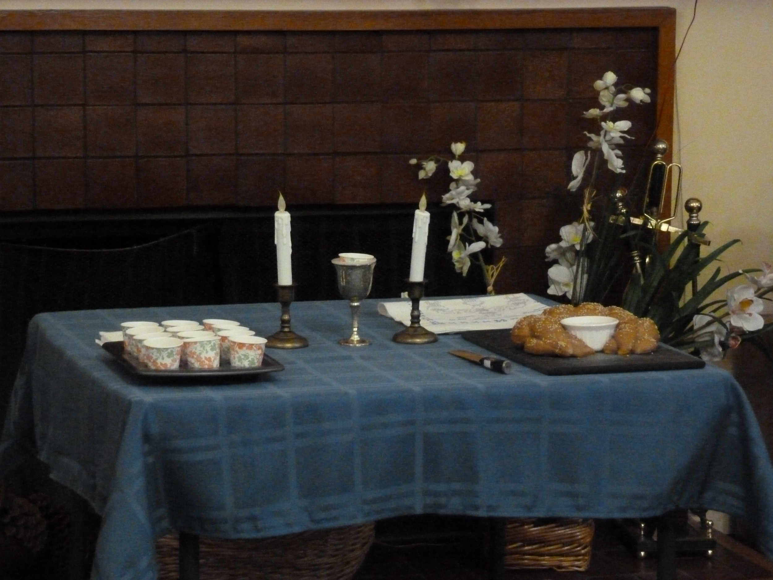 Challah, Kiddush cup, and candles.