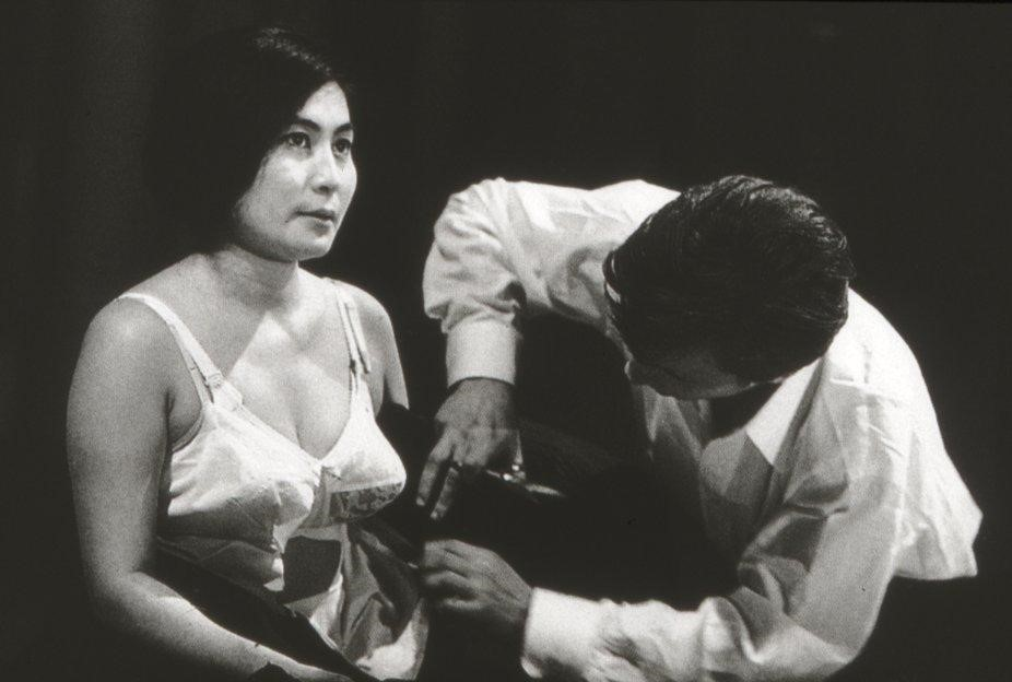 (Yoko Ono performing her art piece Cut Piece)