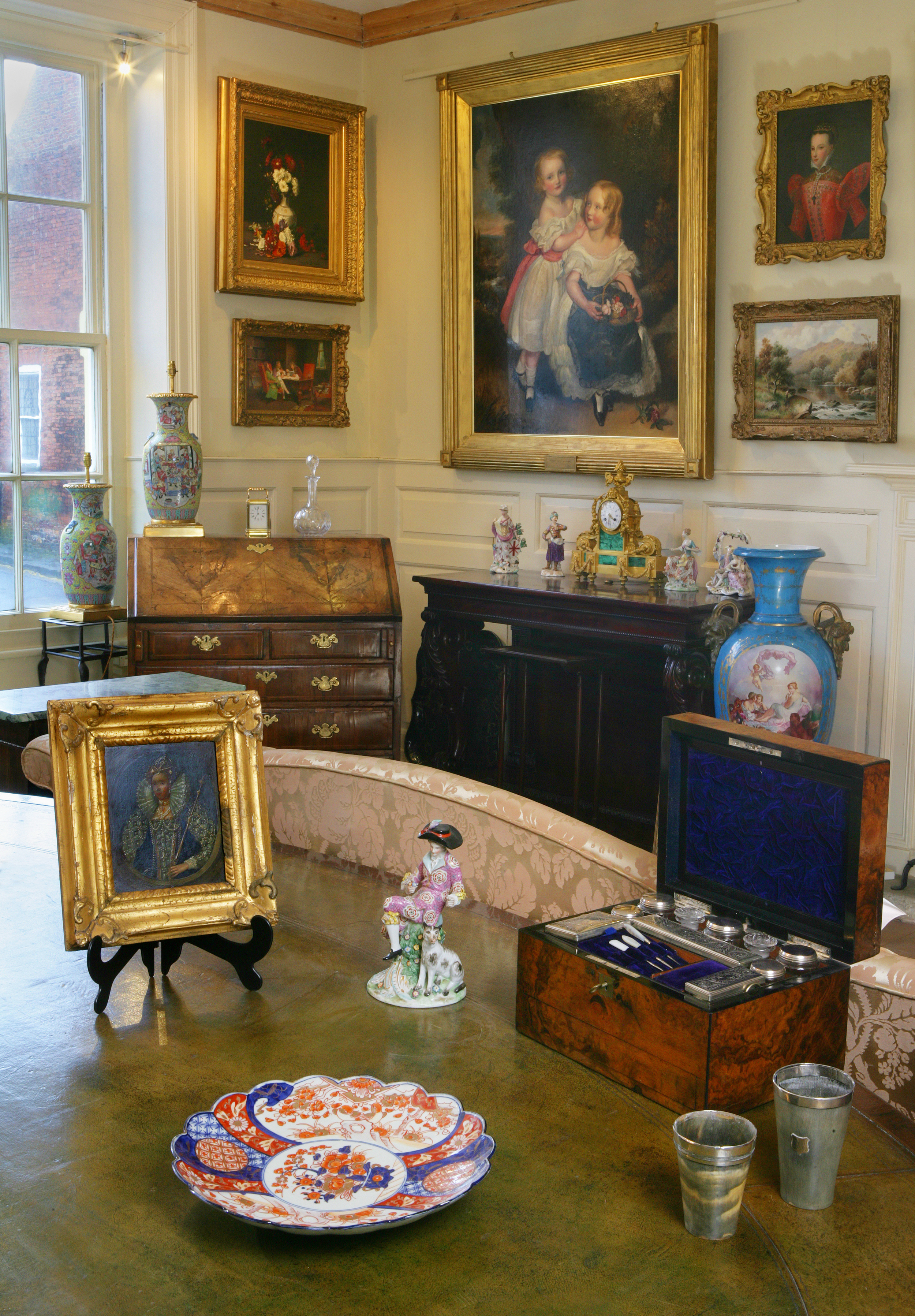Illustrating a traditional interior, full of very fine antiques and paintings.
