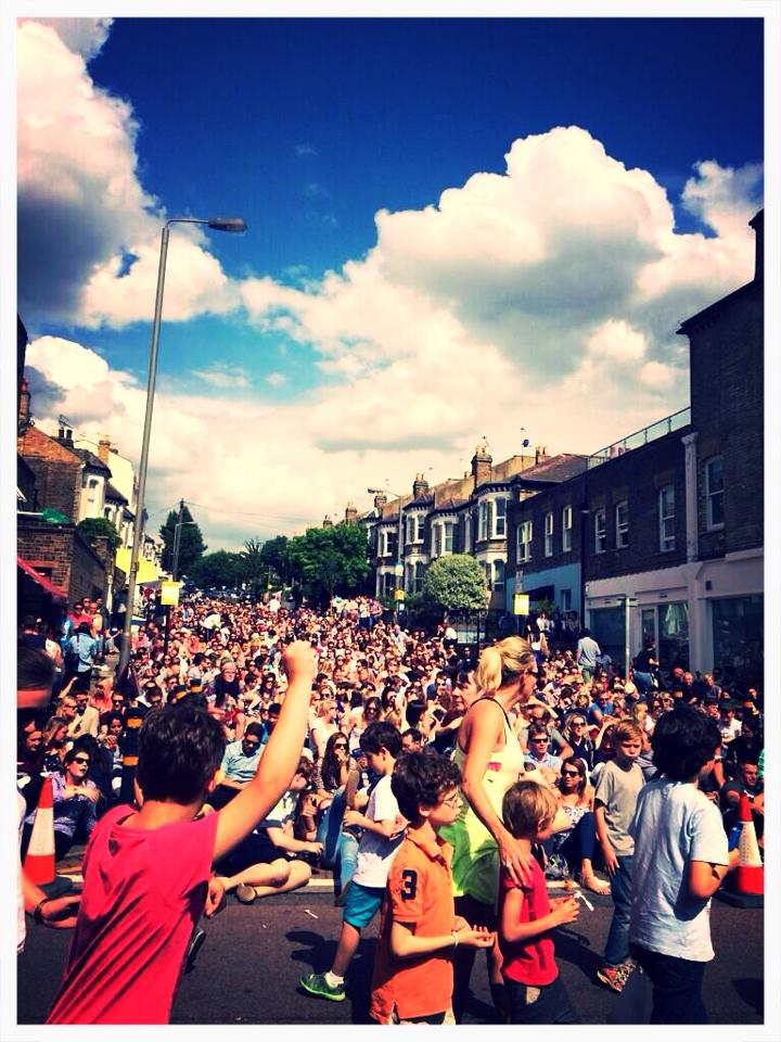 The crowds celebrating Djokovic winning Wimbledon 2014 in the sunshine on the big screen. photo Matt Shearing.