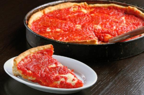 deep dish cheese pizza- slice on plate.jpg