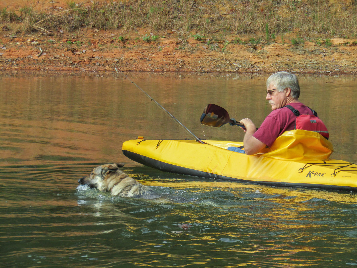 Pete paddling with his dog, Nahla.