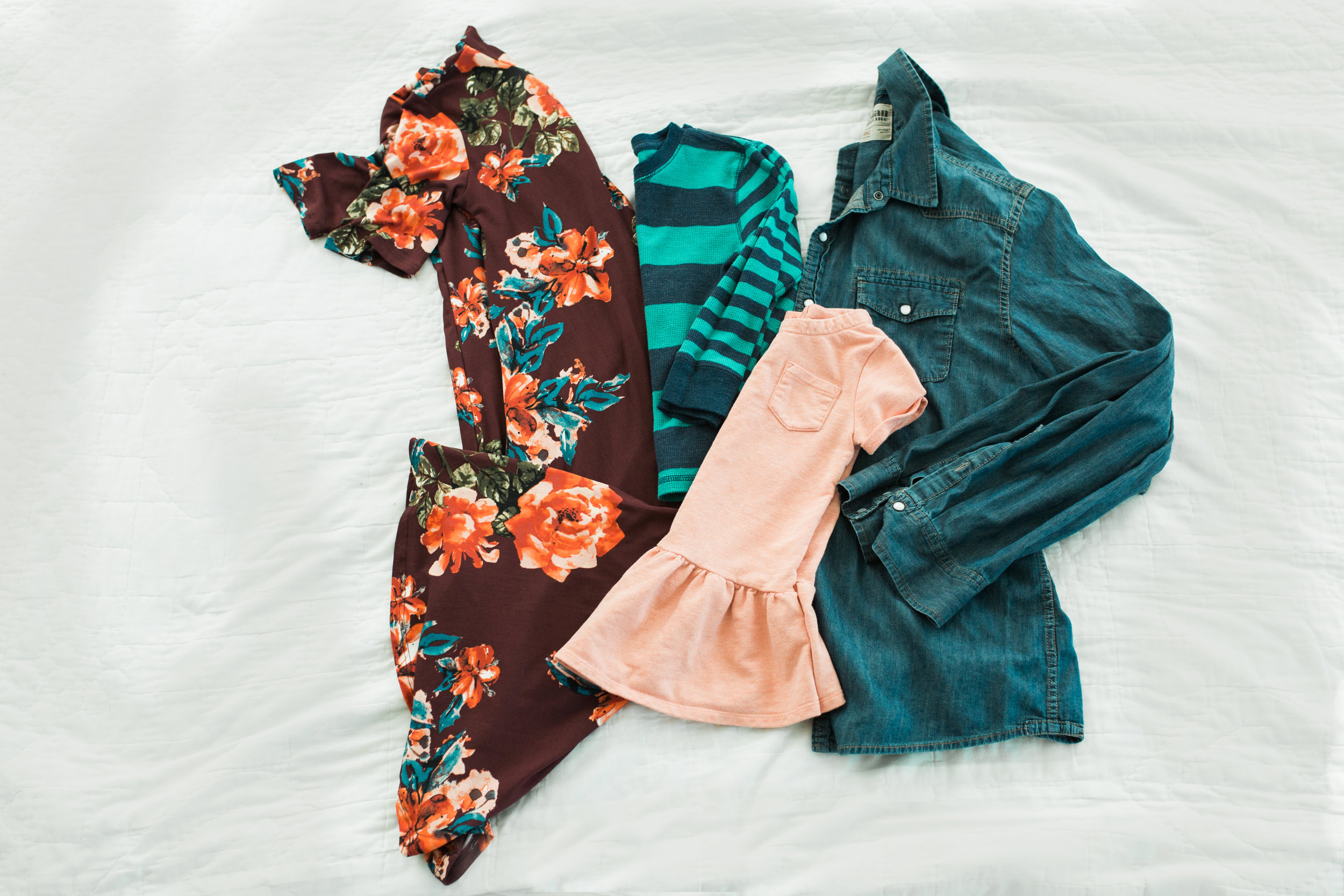 This is a very colorful arrangement. My only one this bright. Fun floral dress for mom, with ankle boots. Girl in complimentary coral dress, maybe with matching headband. Boy in striped aqua/navy thermal (colors in moms dress). Dad stays neutrtal in chambray shirt and khakis.