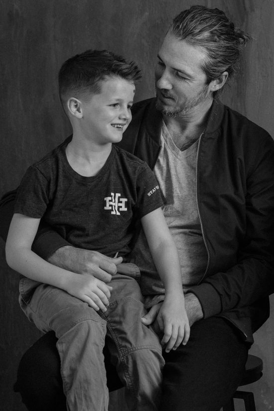 Paul Catlett with his son (Photo courtesy of Hudson Hawk Barber and Shop)