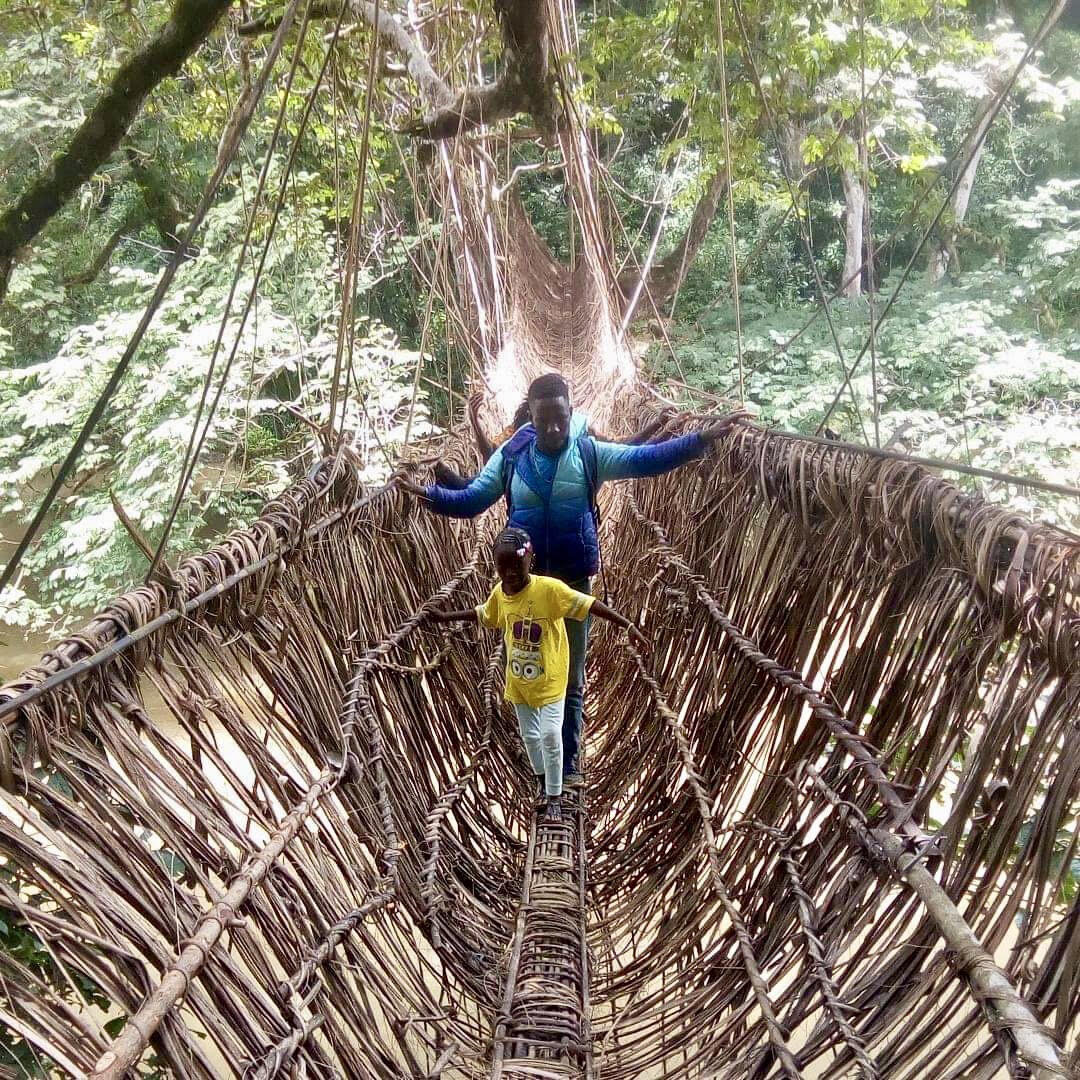 Moses crossing the monkey bridge on his way home to his village
