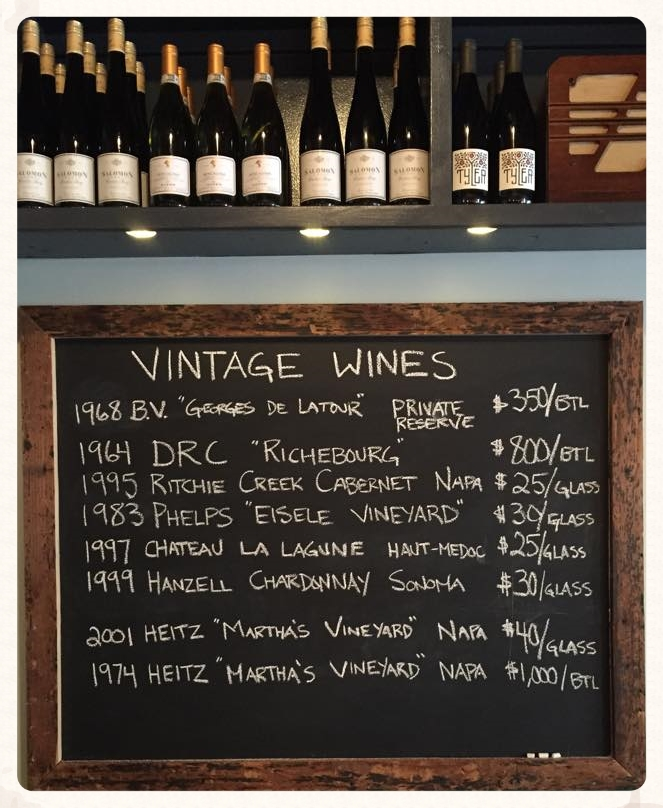 Augustine vintage bottles and wines by the glass