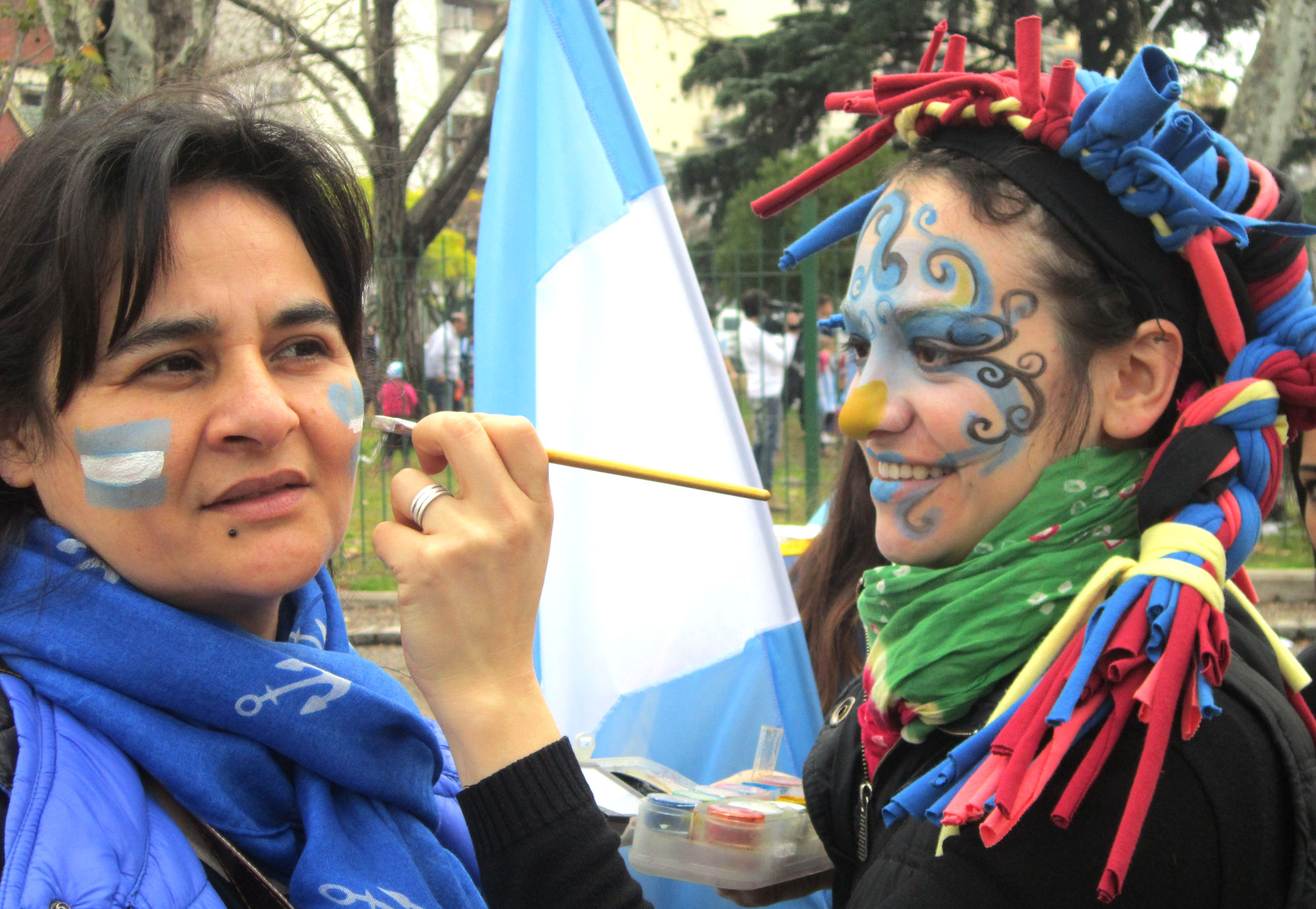 This face-painter was kept busy before the match