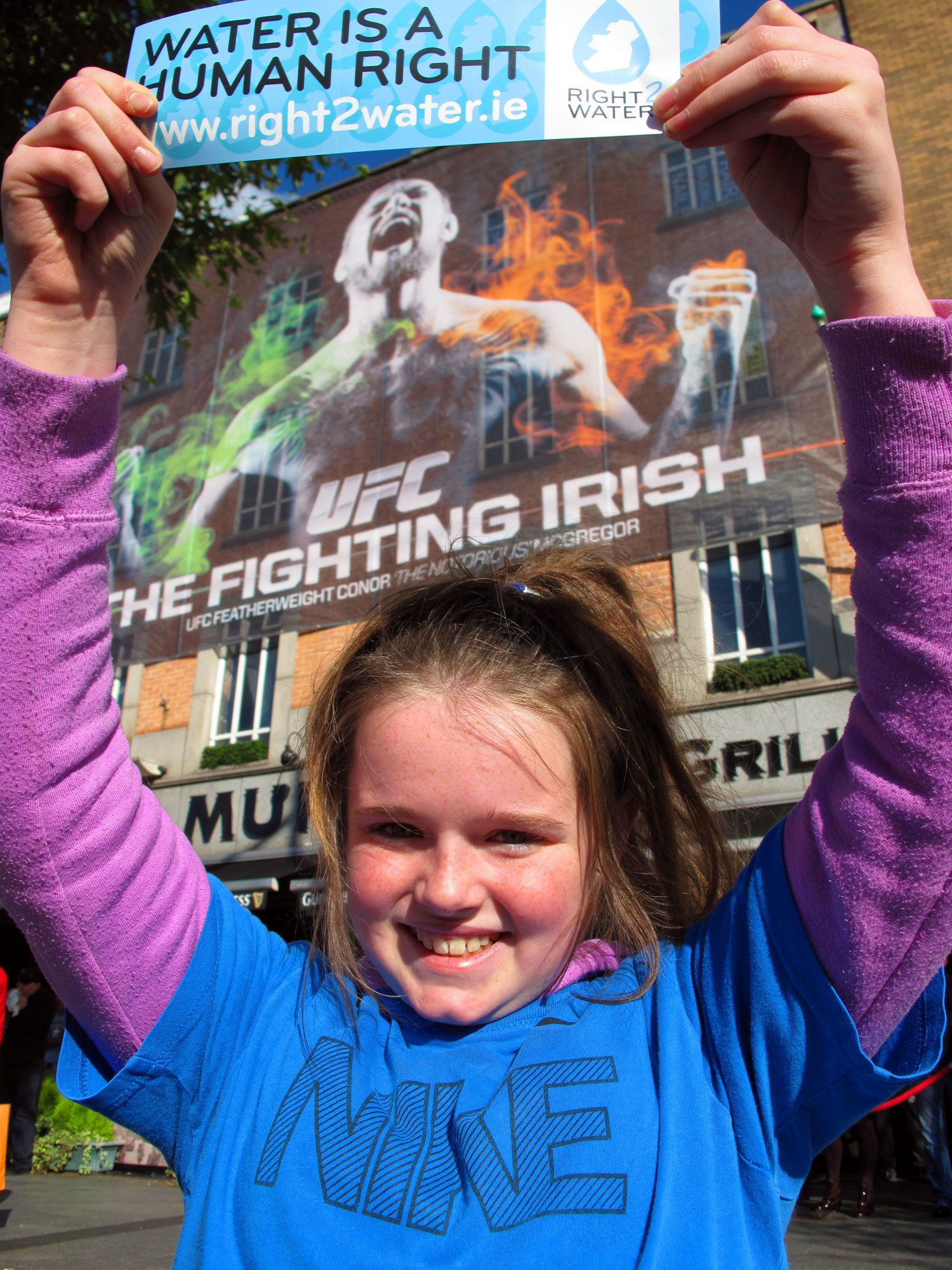 Clodagh O'Brien holds a water protest sticker in support of the protests.