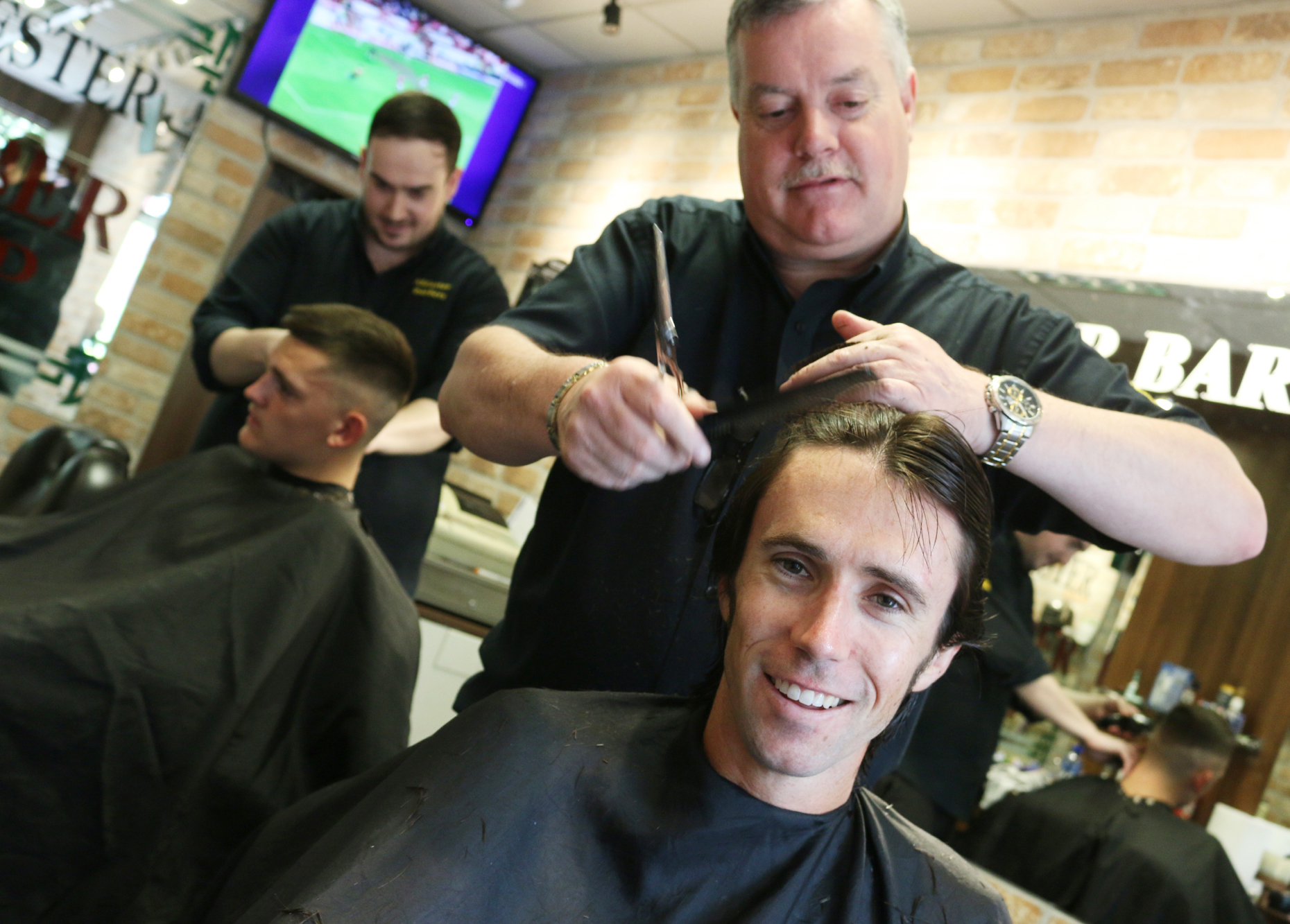 Olympian Mick Clohisey gets his haircut at Killester Barbers. Mick will be participating in the Men's Marathon on August 21st at this year's Olympics in Rio de Janeiro. Photo taken June 10th 2016. Thanks to Derek and Dave at Killester Barbers for allowing me to take the photo.