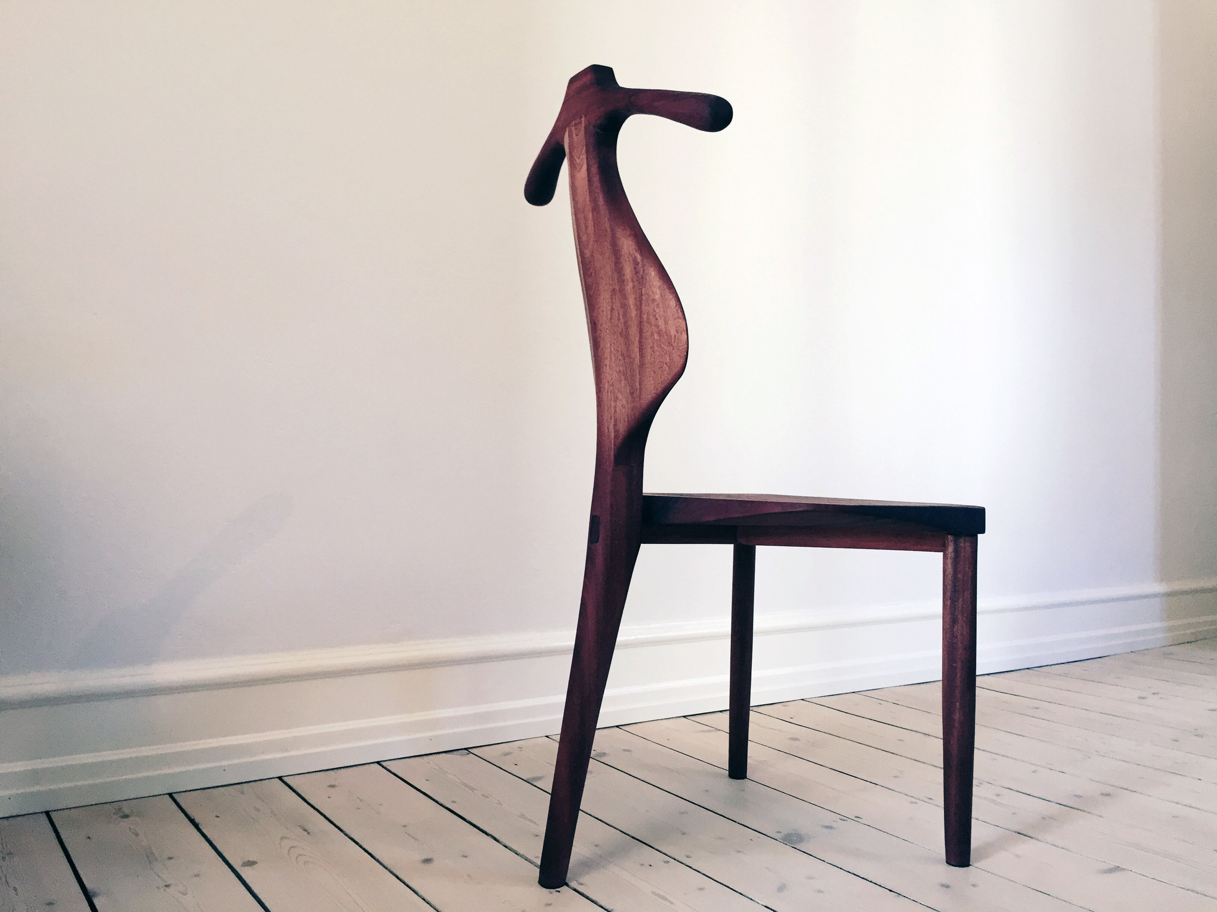 Valet Female   A tribute to master Hans J. Wegner and his iconic  PP250 chair . The project is a design and making of a new unique chair for the female, made from Mahogany wood retrieved in a through-away-dumpster. A project to illustrate design evolution and up-cycling processes from trash to an articulated design object. And the simple passion of designing and making with high quality wood materials. See short film of its making at project page.