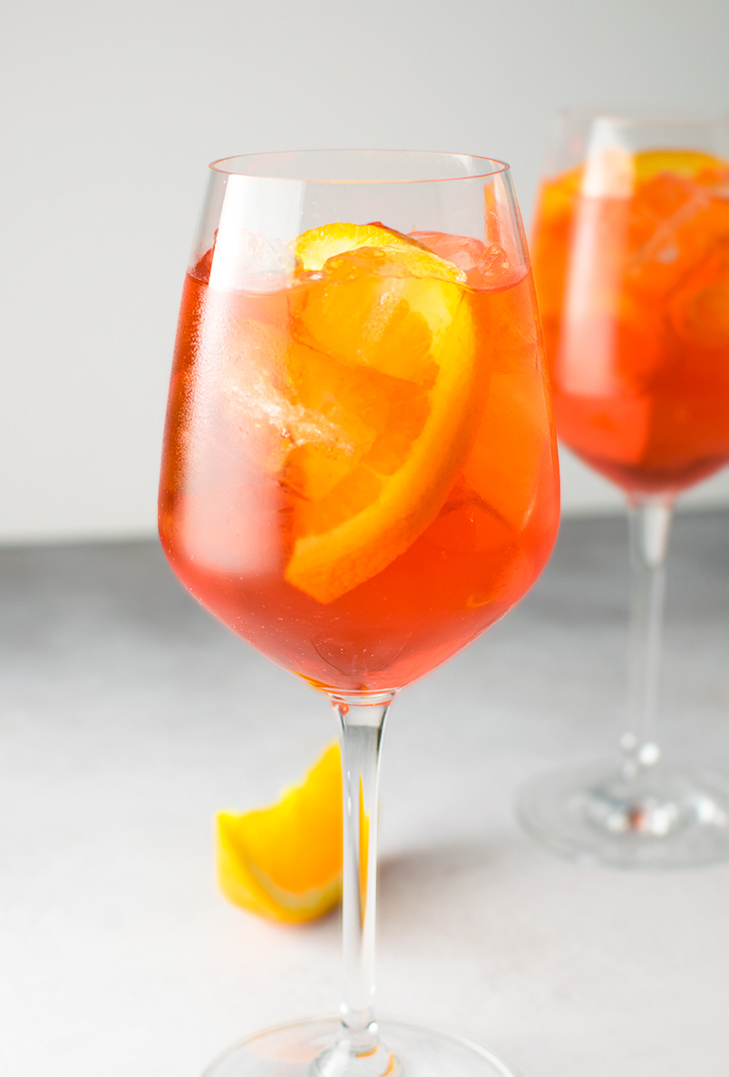 Photo and recipe by  Kitchen Swagger.   There is no denying that the classic cocktail, the Aperol Spritz, has been making a huge comeback this season. We've seen it popping up on wedding day bar menus and are loving the reemergence of this classic drink.