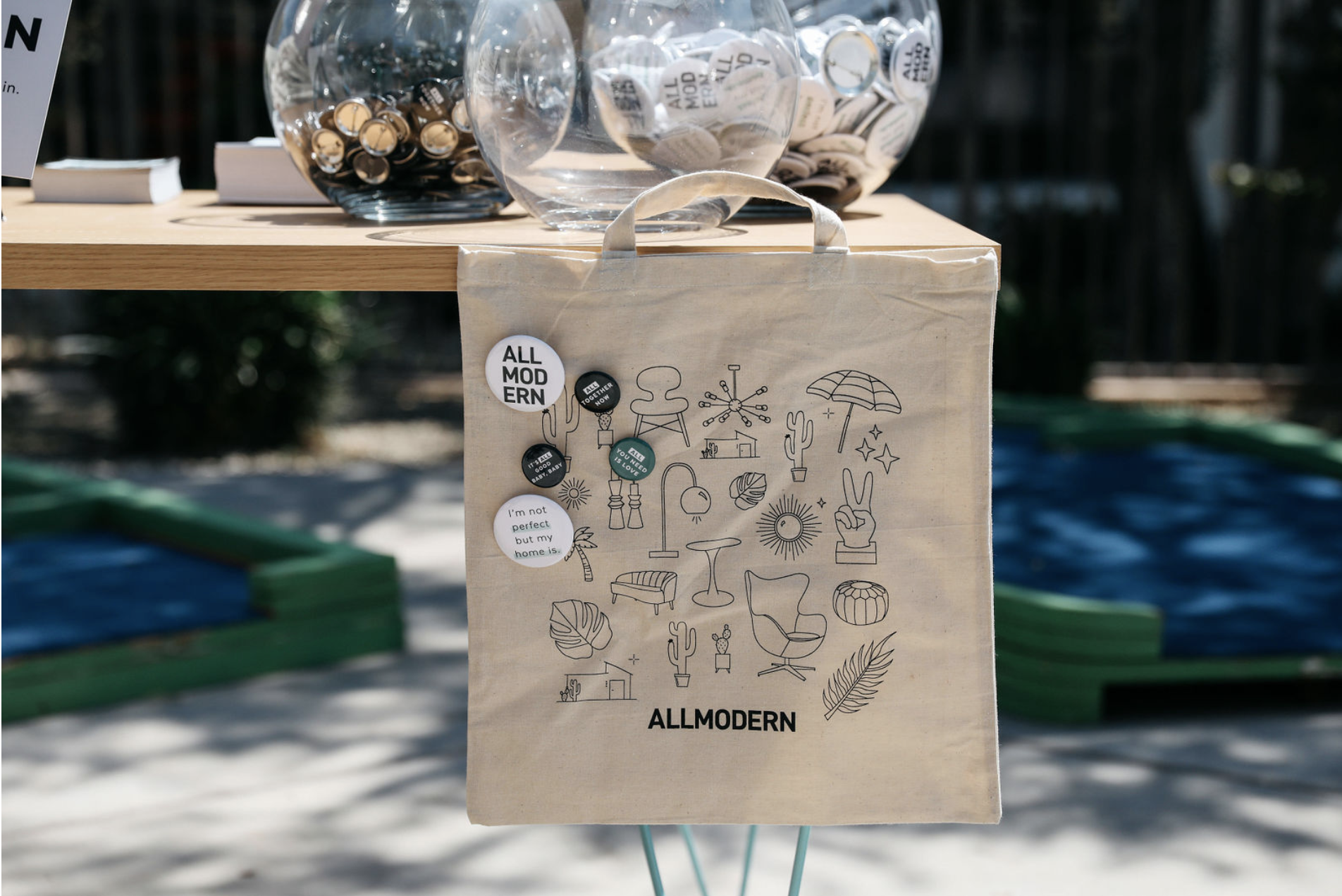 Welcome table with custom AllModern tote bag and pins. Image courtesy of Nicole Breanne.