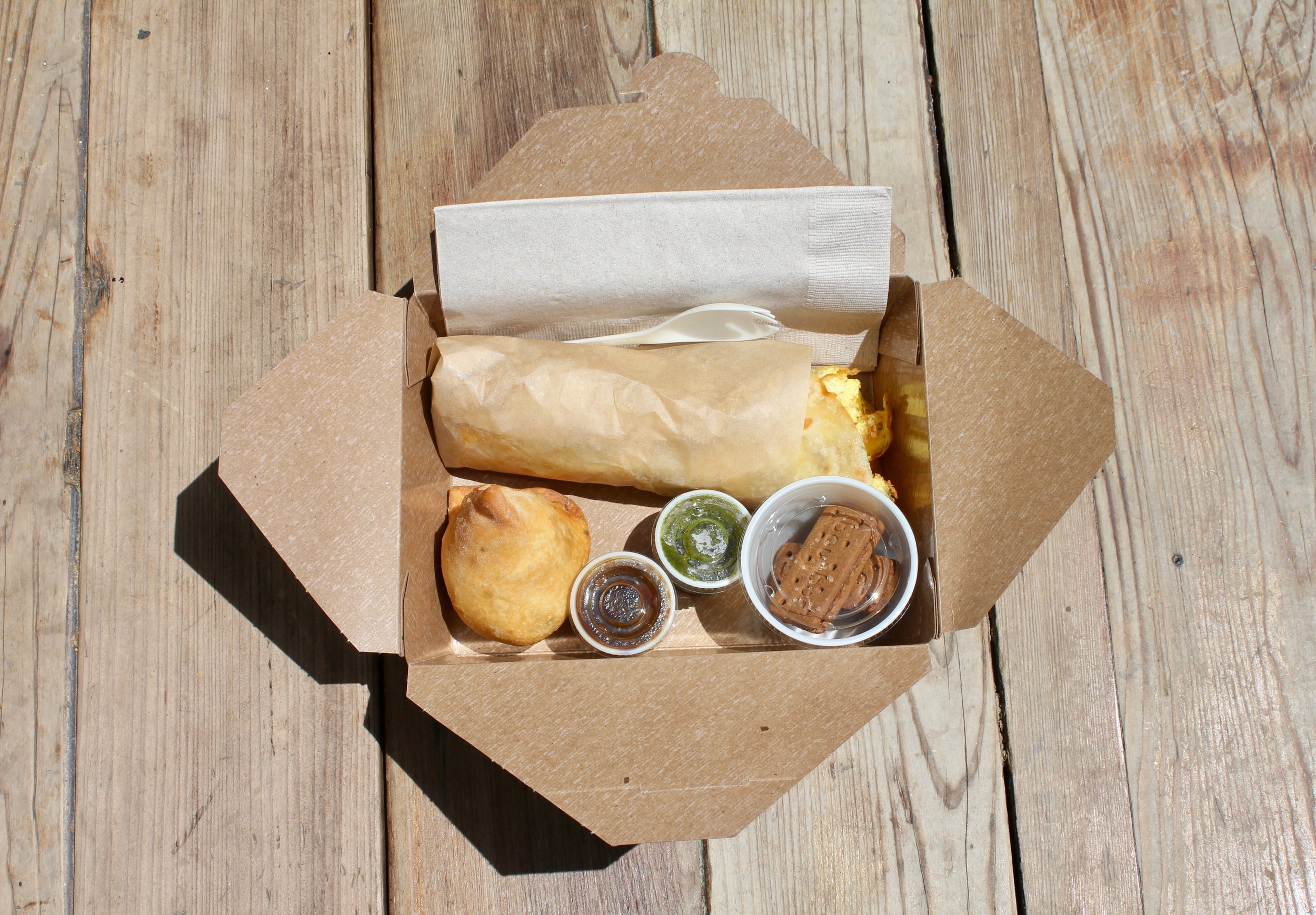 KATHI ROLL BOX    $13.5/person  each box includes a kathi roll, samosa w/chutneys and indian cookies  ask to exclude egg (V)    choice of:    chicken paneer (VG) vegan plant protein (VG, V - no egg) aloo gobi (VG, V - no egg) lamb ($1)