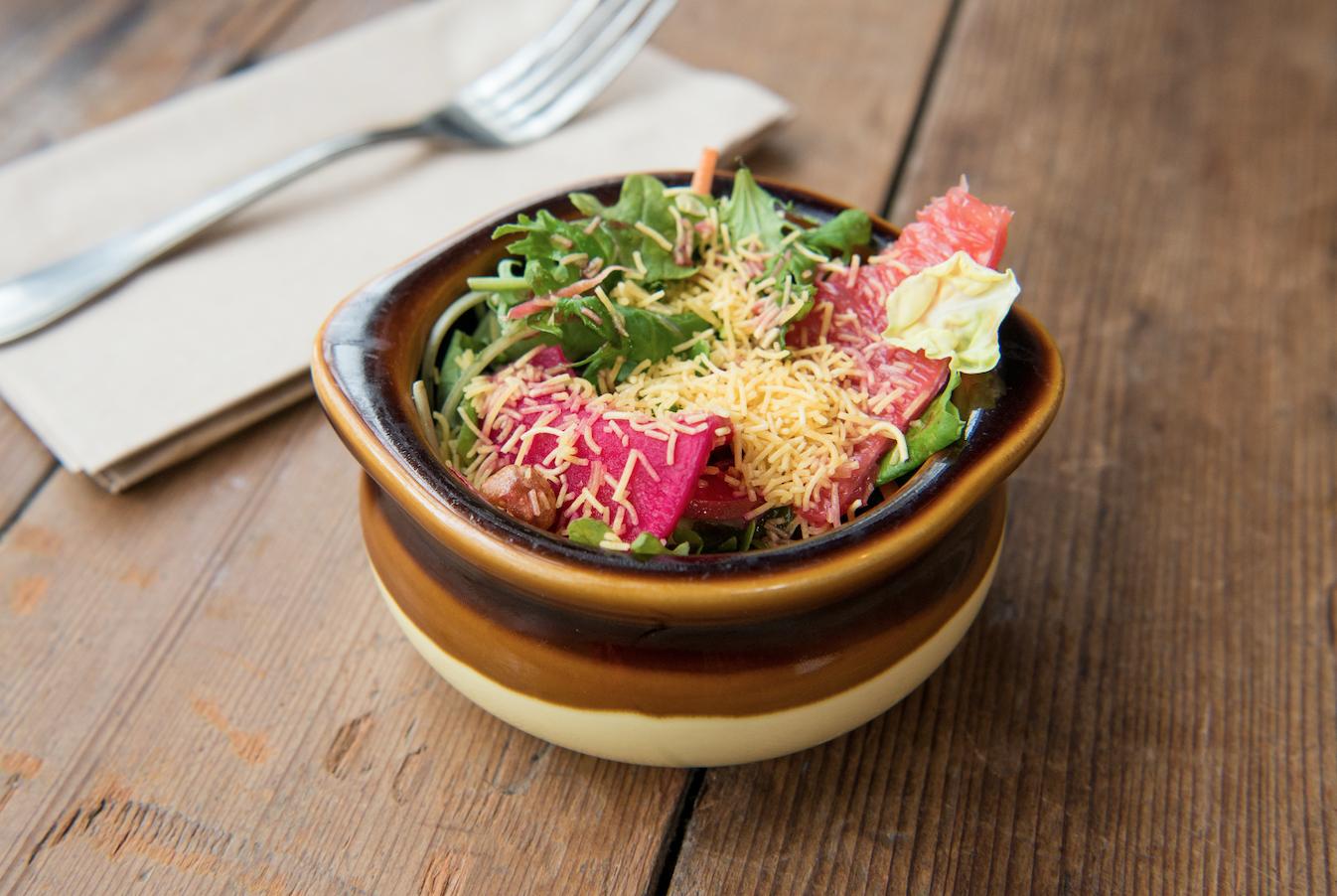 SIDES & EXTRAS   kulcha naan (VG) - serves 25.....$40 papadum & pico kachumber (V) - serves 25.....$30 side salad small (V)- serves 25.....$50 side salad large (V) - serves 40.....$85 cilantro chutney (V) - 12 oz.....$8 tamarind chutney (V) - 12 oz.....$8 raita (VG) - 12 oz.....$8 napkin, plate, spork.....$1/person