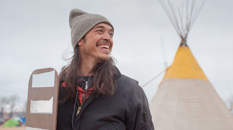 Artist Cannupa Hanska Luger holds one of his mirrored shields at the Oceti Sakowin Camp in Standing Rock, N.D. (The UnKnown Collective / from Cannupa Hanska Luger)
