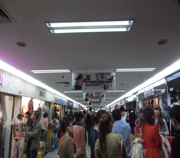 A narrow hallway lined by fashion showrooms in Guangzhou's wholesale market for trendy, low-cost garments and accessories. Photo credits: Nellie Chu