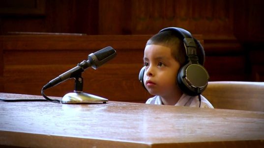 Unaccompanied boy defends himself in court without attorney or caretaker.  Source