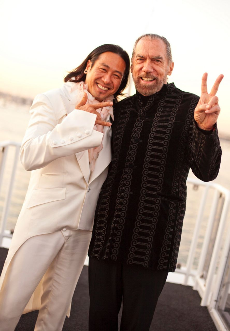 Alee and John Paul DeJoria posing at a JJ The DJ event.