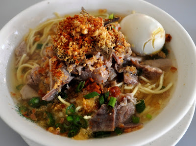 Batchoy  (Miki noodles in a pork broth topped with pork organs, leeks, chicharon, and an egg), courtesy of the original Ted's La Paz Batchoy in Iloilo. Photo:  Life's Best Secret  s  by Monique De Jesus.