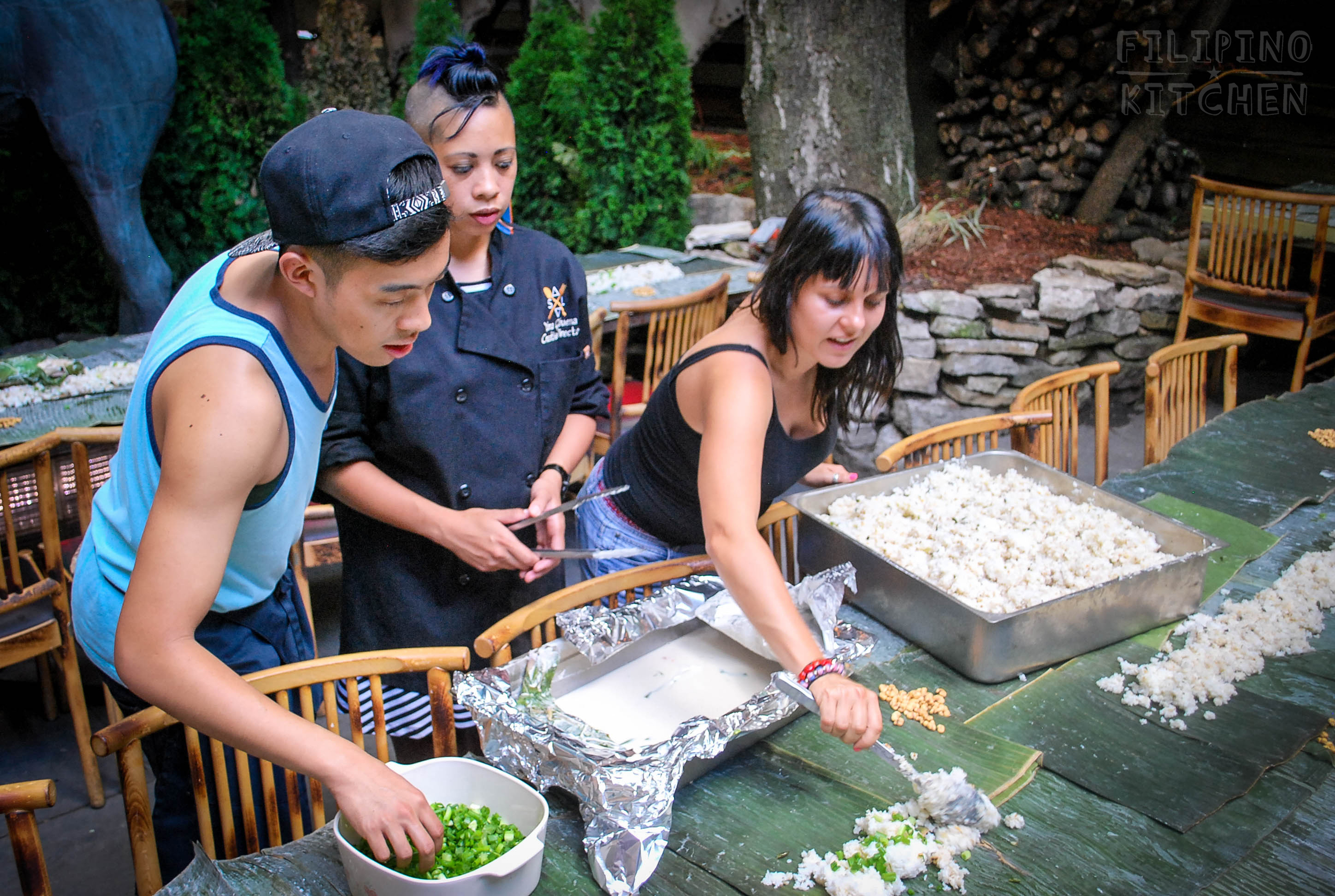 Readying the  sinangag  over a table of banana leaves, Chicago.Left to right: Paolo Espanola AKA The Errant Diner and #FKEDUP collaborator, Chef Gilbuena, and videographer Cassandra Sicre.
