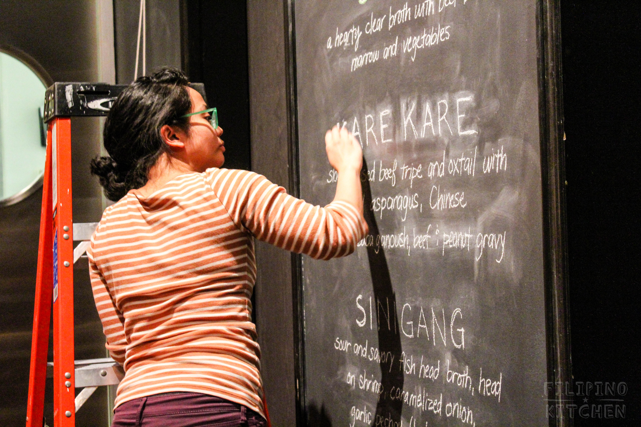 Without a ruler (!!) Angeline Mascareñas of Escolta St. Snatchers Social Club drafts our menu boards.
