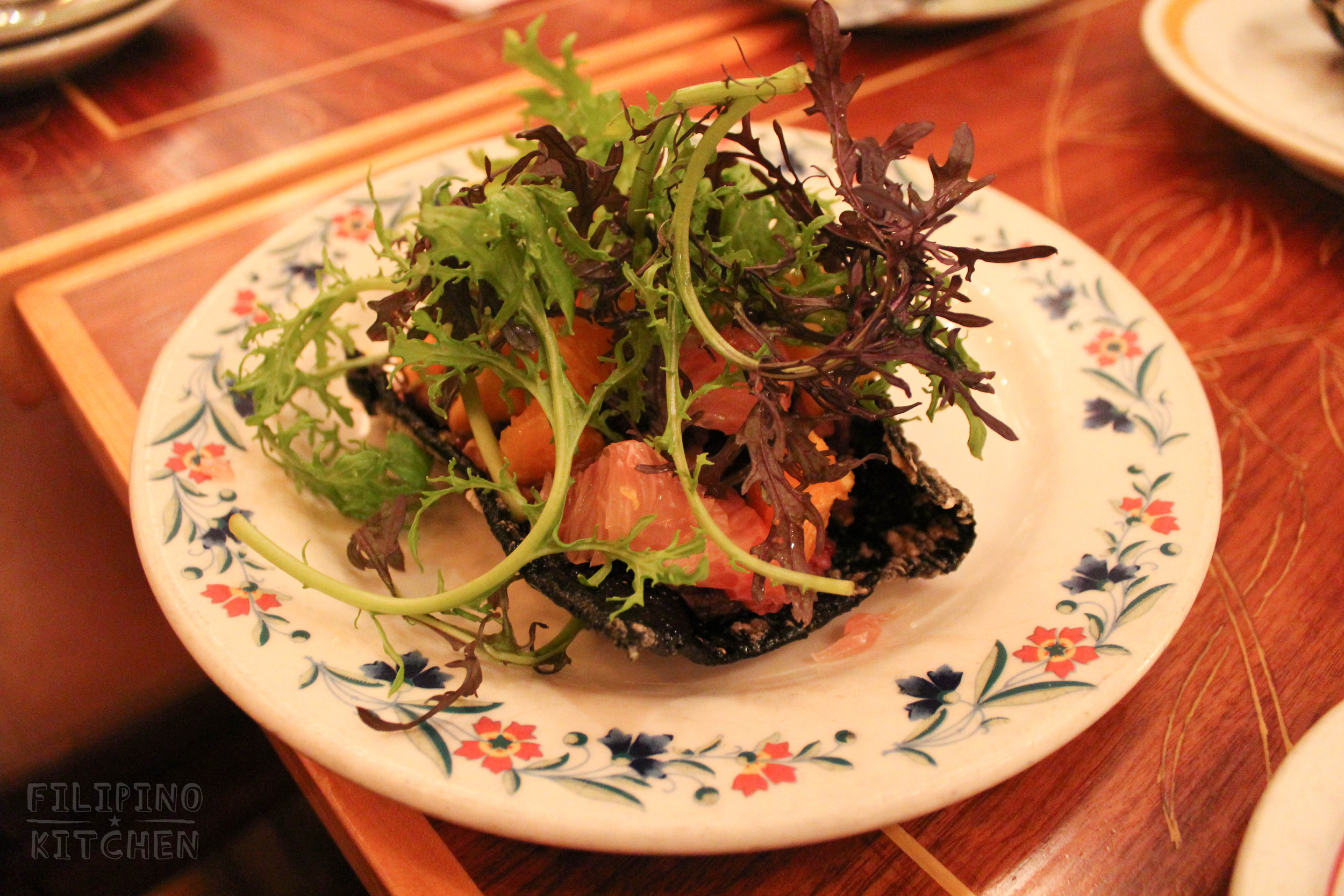 Taco Nori:beef tapa, fried garlic heirloom rice, pomelo, persimmons, oranges, spring mix nestled in a crispy nori (dried seaweed)