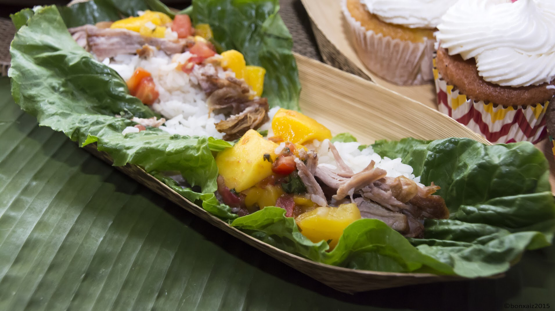 Detail of pork lechon lettuce wraps, foreground, and tropical cupcakes by Chef Joelen Kenny of What's Cookin' Chicago!?Photo credit: Gen Odon