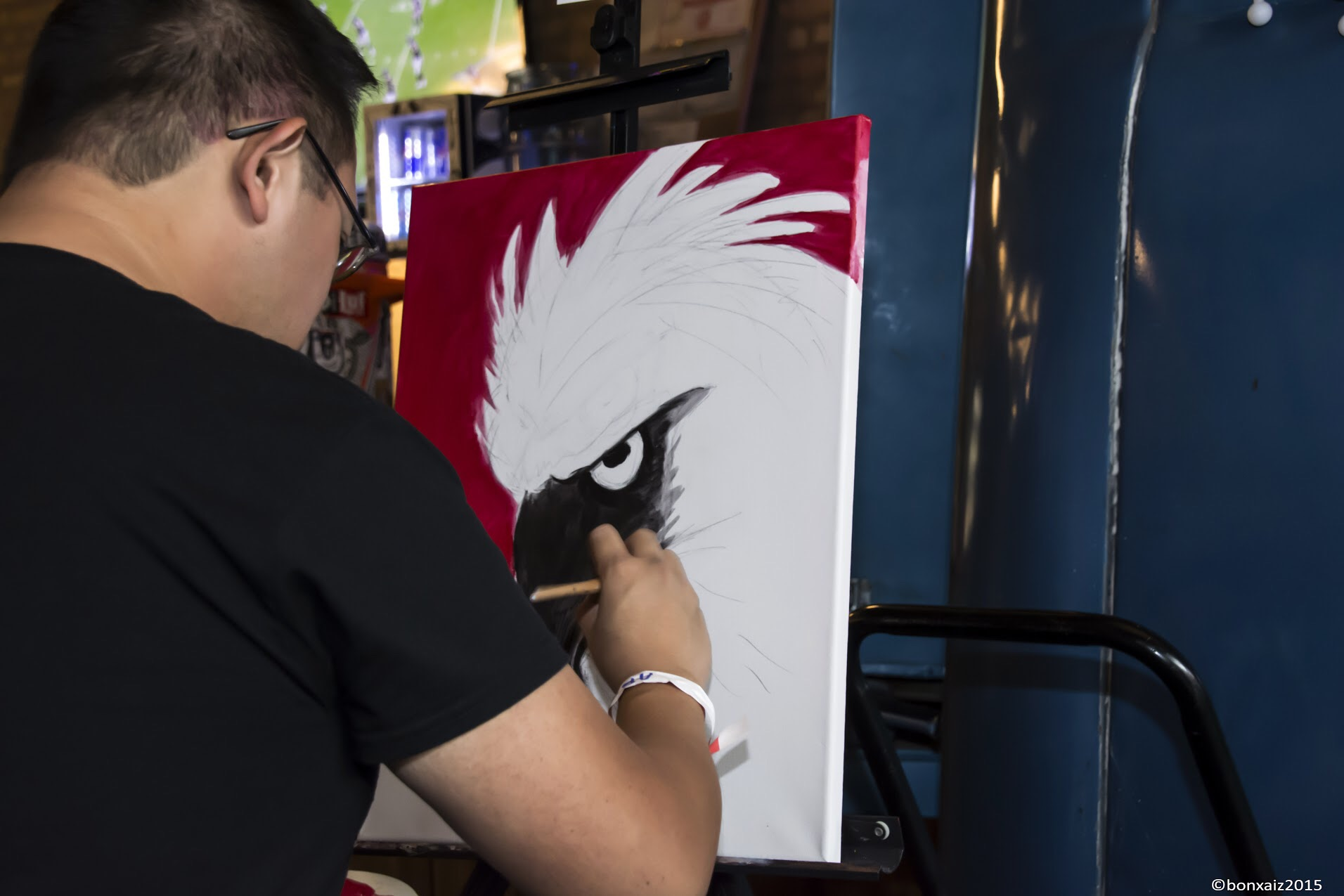 Painter Chris Gallevo sold two of the works he created on-the-spot.Photo credit: Gen Odon