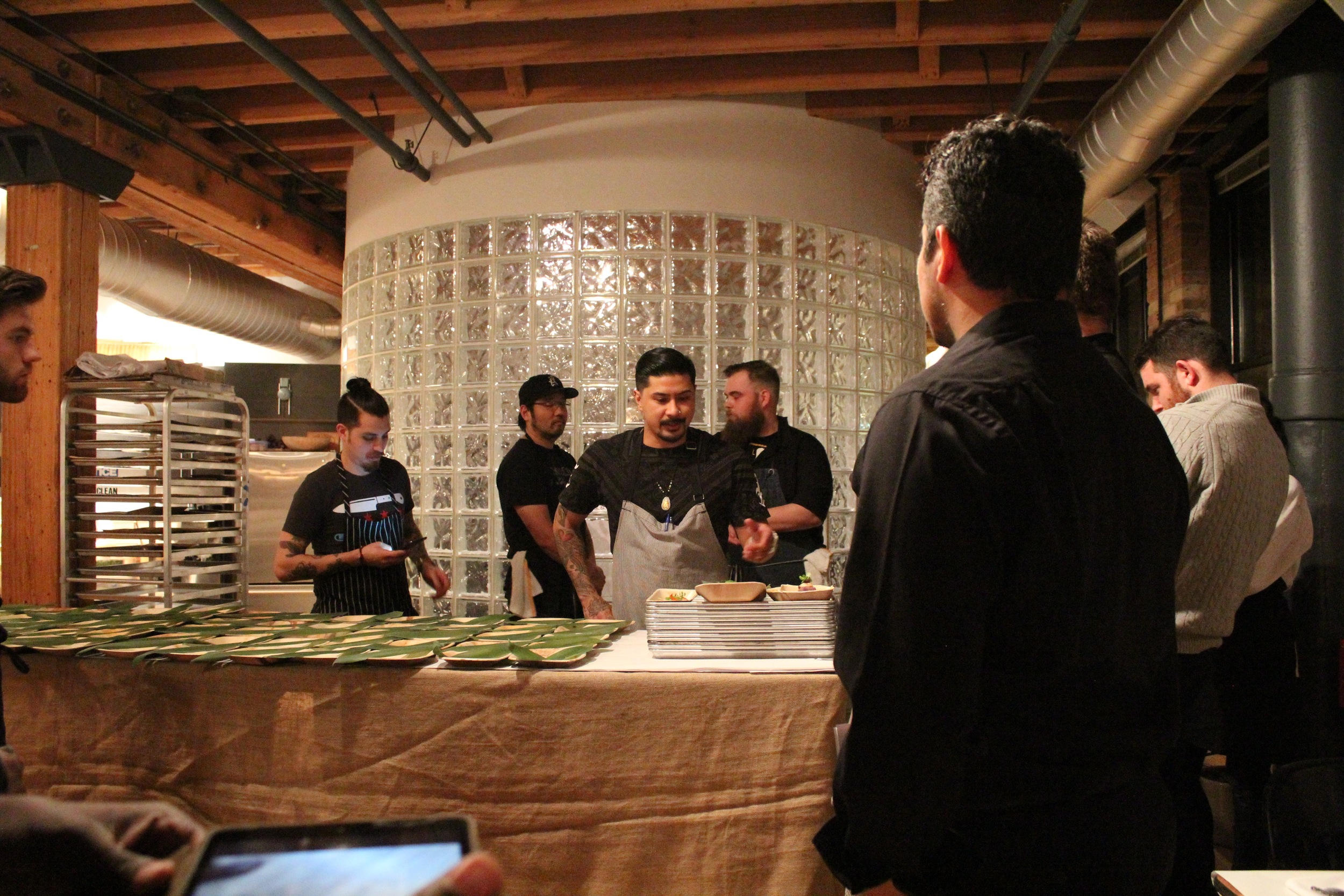 Chef Bryan prepares his cooks and servers for service with a run-through of the menu's finished plates.