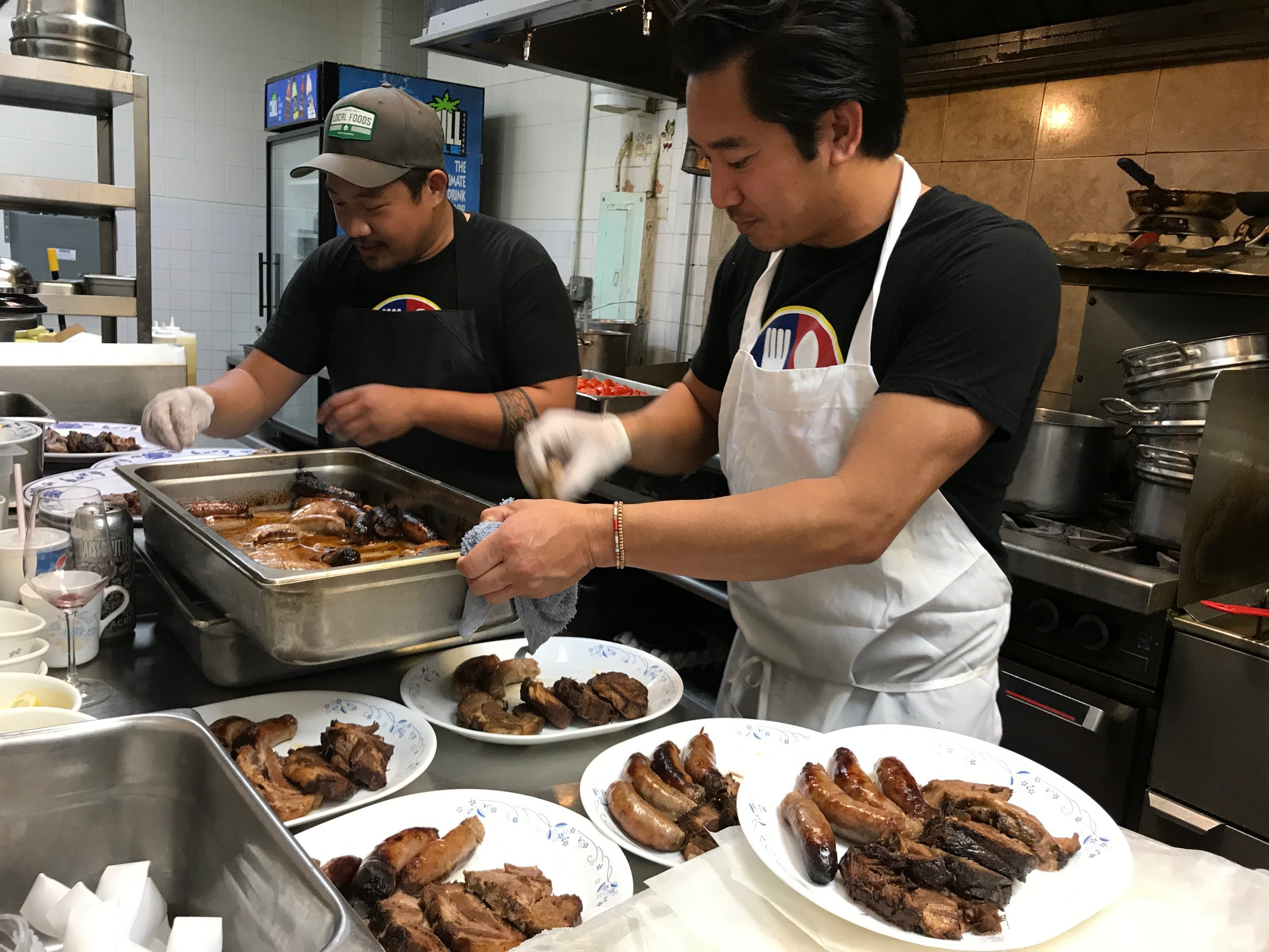 Chef Carlo and cousin Mel Lamagna plate the dinuguan for the Twisted Filipino Kitchen pop-up dinner, Uncle Mike's Place, Chicago, May 2017.