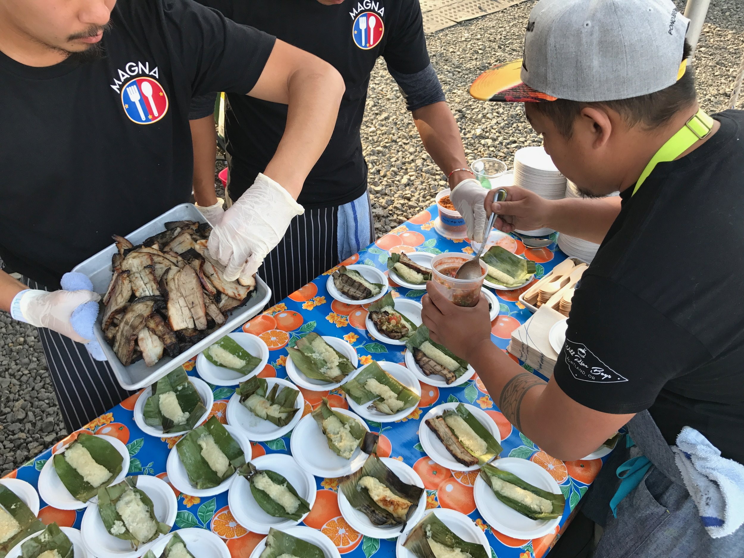 Plating suman at liempo, Chef Carlo Lamagna at Feast PDX Night Market.jpg