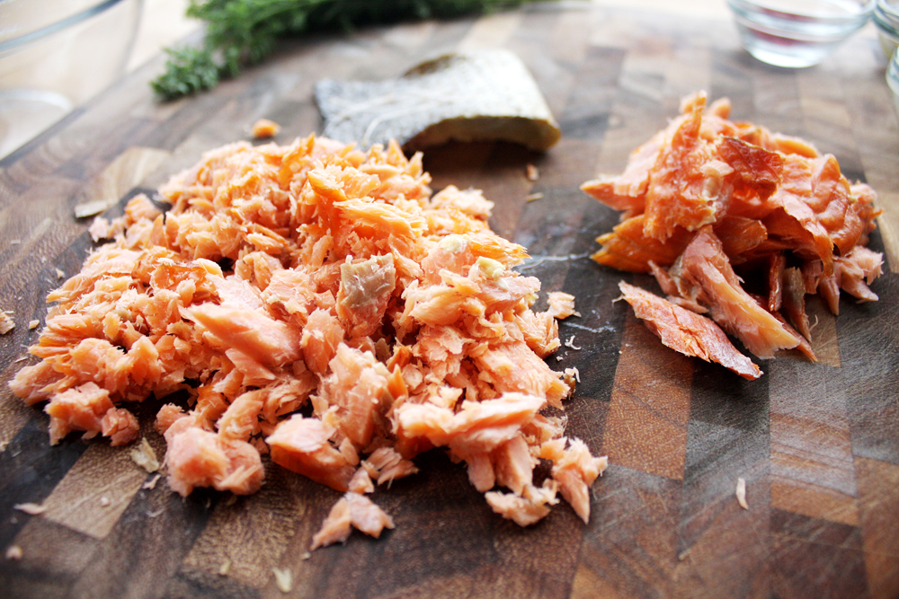 Flake about a quarter of your smoked salmon fillet into pieces to top of your eggs. Rough chop the rest.