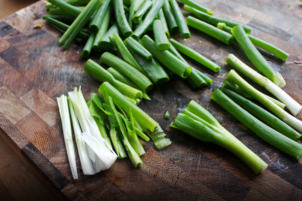Cut off the roots of the green onions, then cut them into 1 inch pieces. If the white parts are too think, slice them in half.