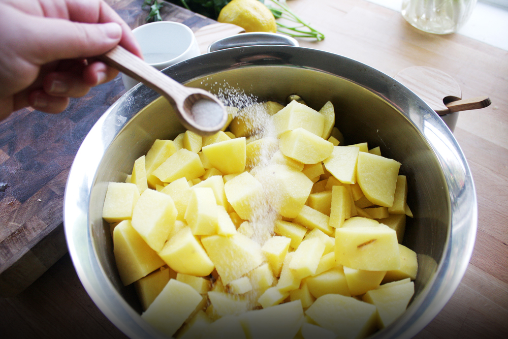 Add a large pinch of salt to the potatoes in a pot and boil for 25 minutes, when the potatoesare tender.