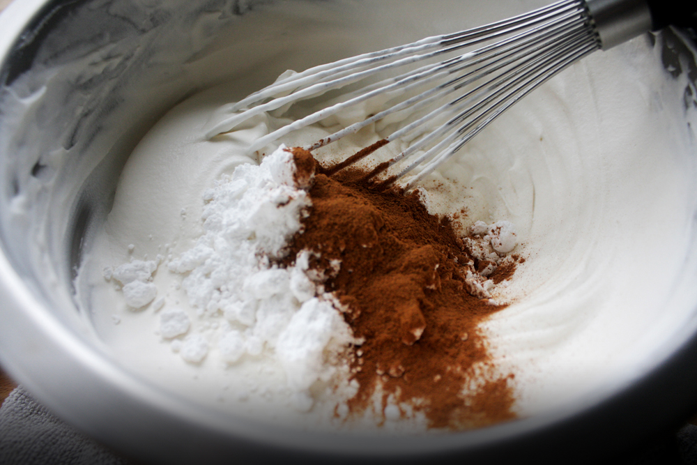 When you get the cream to your desired firmness, add in the vanilla, powdered sugar and cinnamon until evenly incorporated.