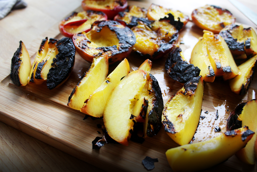 Slice the peaches for serving. If you wanted char on all sides, you can slice to smaller sizes before you grill, but they will be a little more difficult to handle.