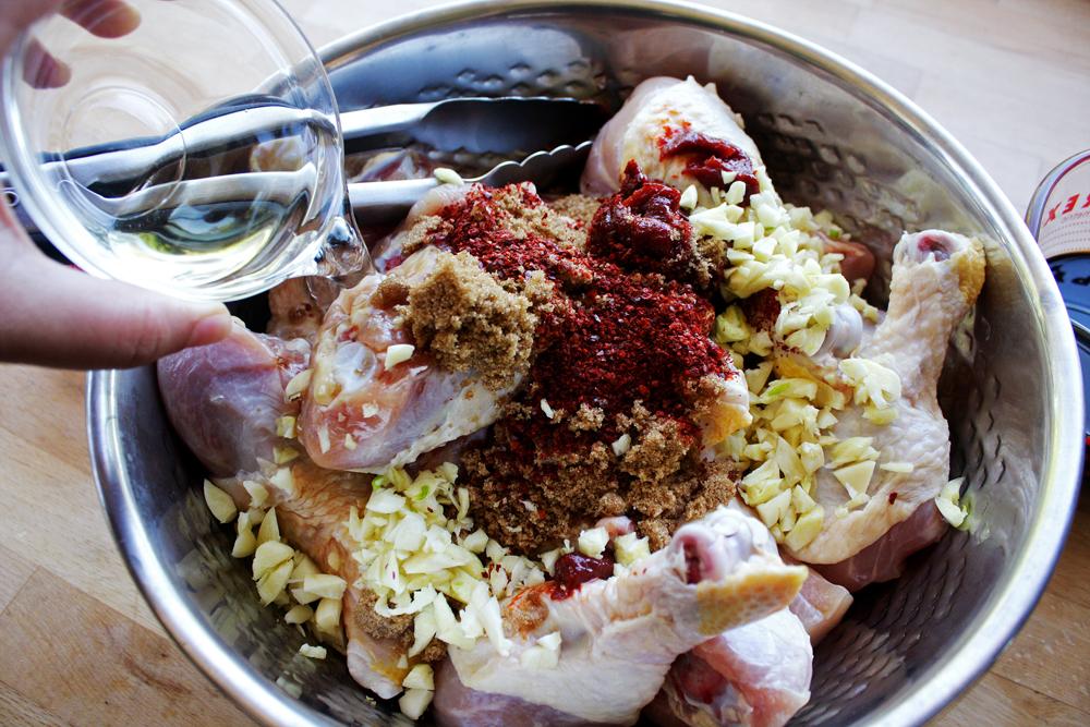 In a large bowl, put the in the chopped garlic, brown sugar, gochugaru, gochujang, rice wine vinegar ...