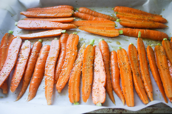 Put the carrots on top of a baking sheet lined with parchment paper. Make sure the carrots are not on top of each other, so they can all brown.