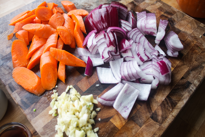 Rough chop the carrots, red onion and garlic cloves.