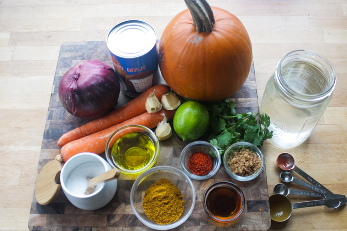 The ingredients: sugar pumpkin, carrots, red onion, garlic cloves, lime, coconut milk, water, curry powder, gochugaru, fish sauce, brown sugar, salt, vegetable oil. Have cilantro for topping and steamed rice on the side.