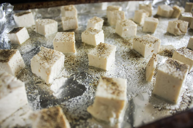 Cook the white rice.  Preheat your oven to 425F. Drained and pat the tofu dry with paper towels. Bake for about 20-30 minutes, depending on how firm you want the tofu.