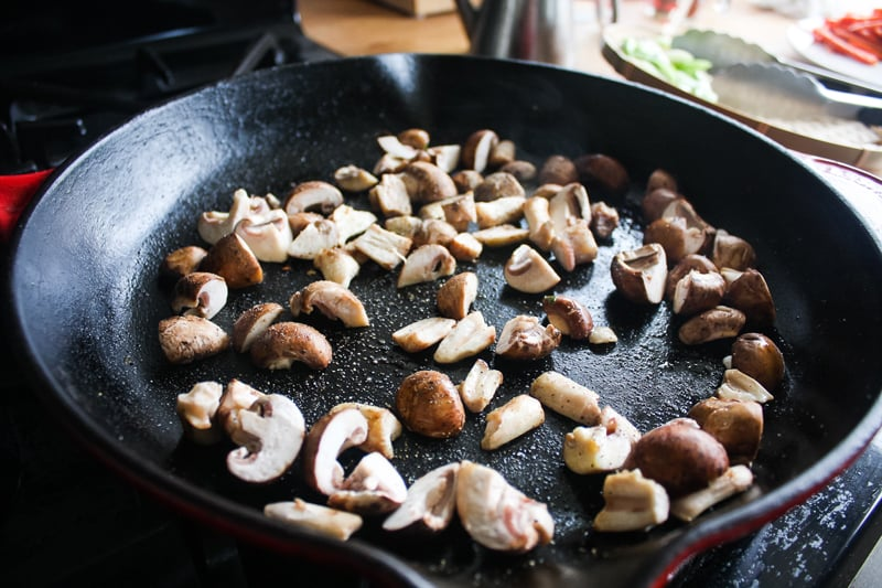 Take out the carrots, then add the mushrooms. Cook until golden, about 5-10 minutes, without stirring too often.
