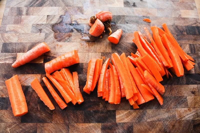 Rough chop the carrots into matchsticks.