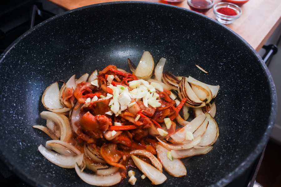 Add the kimchi and garlic and cook for about 5 minutes.