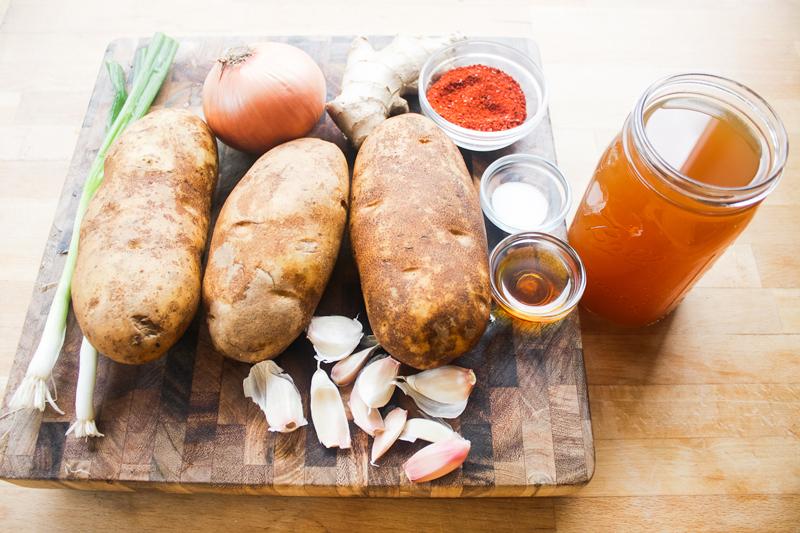 The ingredients: russet potatoes, white onion, garlic, ginger, vegetable stock, green onion, gochugaru, sesame oil, salt.