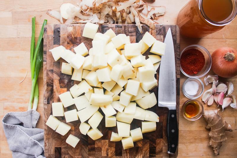 Peel then cube the potatoes.
